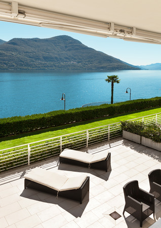penthouse: beautiful terrace of a penthouse overlooking the lake, outside