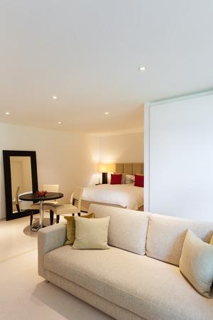 Modern interior design of comfortable bedroom photo