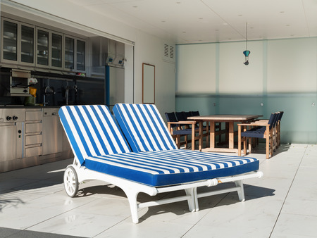 sunbed: terrace of a penthouse with two sunbed outside Stock Photo