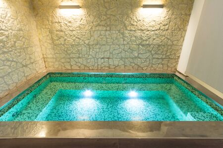 light  house: modern hotel spa interior with hot tub, stone wall