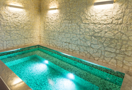 Modern Hotel Spa Interior With Hot Tub, Stone Wall Stock Photo   39040691