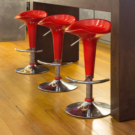 stools: counter top with red stools