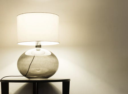 bedside lamp: Interior of modern house, detail living room, table lamp