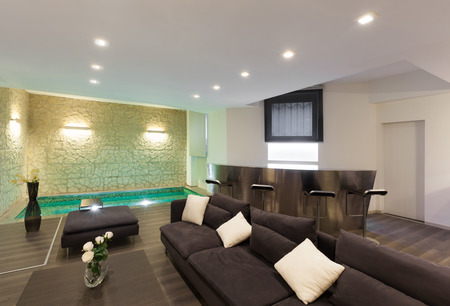 wide loft with modern furniture in living room