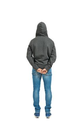 in the back: Retrato del hombre joven aislado en un fondo blanco, vista posterior Foto de archivo