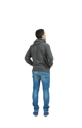 Portrait of the young man isolated on a white background, back view