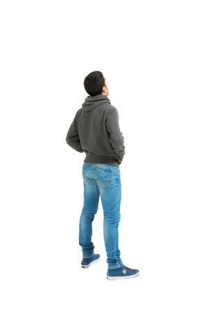 espalda: Retrato del hombre joven aislado en un fondo blanco, vista posterior Foto de archivo
