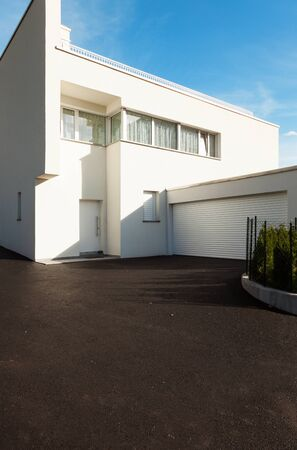 garage on house: modern house white with garage , view from the courtyard