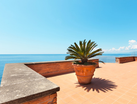 ocean plants: outside exterior with sea view from terrace Stock Photo