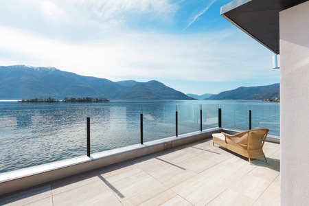 outside of house: modern architecture, beautiful lake view from the terrace of a penthouse Stock Photo