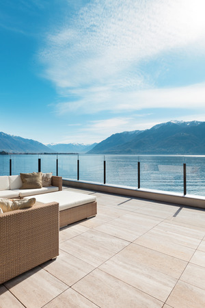 balcony design: modern architecture, beautiful lake view from the terrace of a penthouse Stock Photo