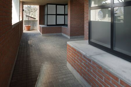 passage: architecture, passage of a modern building in bricks and cement
