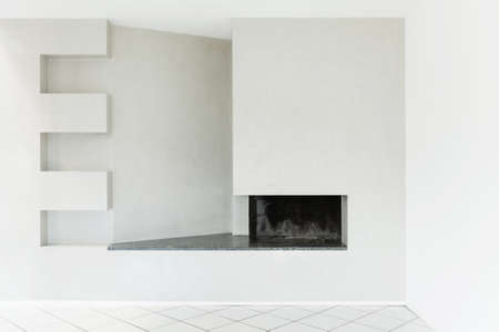 tiled wall: Architecture, Interiors of empty apartment, room with fireplace Stock Photo