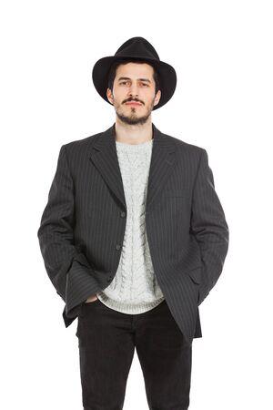 hombre con sombrero: Hombre joven con un sombrero aislado sobre fondo blanco Foto de archivo