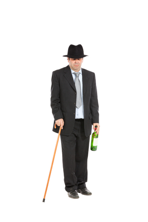 abusing: drunk man with stick and hat, isolated over white background