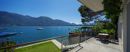 landscape garden: Lake view from the balcony of modern villa