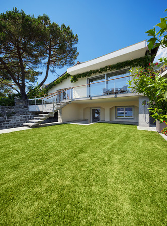 Outside of villa with garden on the lake with berth Stock Photo