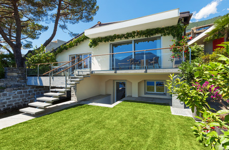 terrace house: Outside of villa with garden on the lake