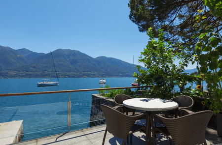 waterfront: Lake view from the balcony of modern villa, summer Stock Photo