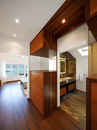 Modern house interior, corridor overlooking bathroom Stock Photo