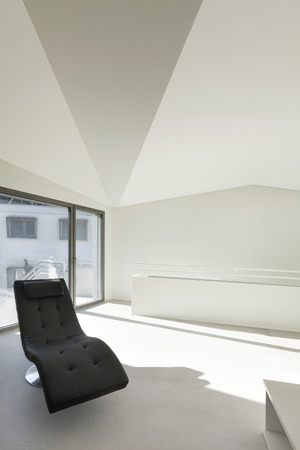 modern chair: Architecture, interior of a modern house, white walls Stock Photo