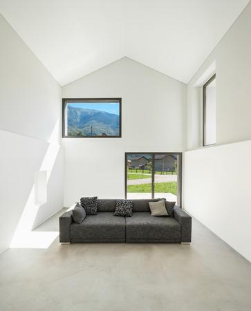 ventana abierta interior: arquitectura, casa moderna entre otras, sala de estar con sofá Foto de archivo