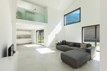 Hormigón: arquitectura, interior de la casa moderna, sala de estar con sofá