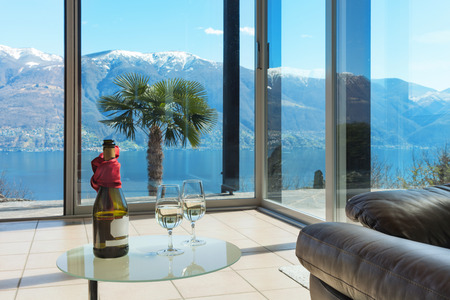 view window: aperitif on the veranda, interior of a mountain home, lake view