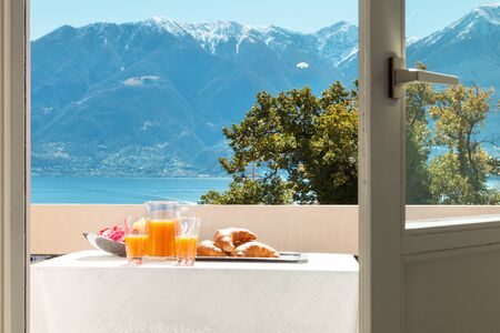 breakfast hotel: traditional breakfast on the balcony of a house, lake view