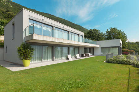 new building construction: modern white house with garden, outdoors