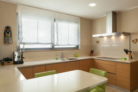 Interior of a modern apartment furnished, wide domestic kitchen