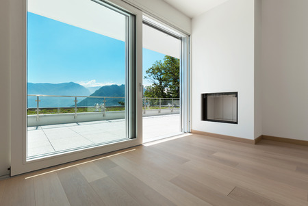 corner house: Interior, corner of a modern apartment, view fireplace and window Stock Photo