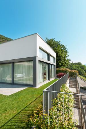 home and garden: modern white house with garden, outdoors