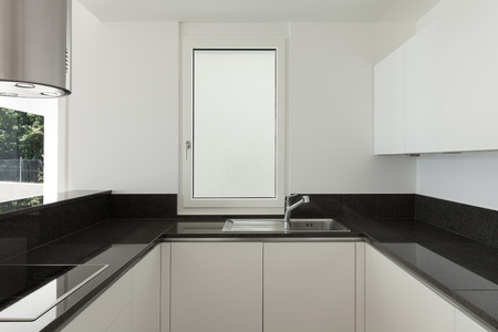 counter top: Interior, empty domestic kitchen of a modern apartment