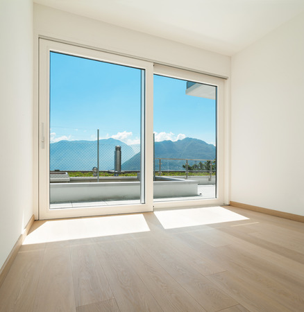wood window: Interior, empty room of a modern apartment with window Stock Photo