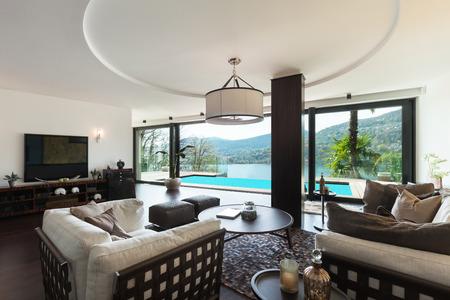 indoors: modern house, pool view from the living room