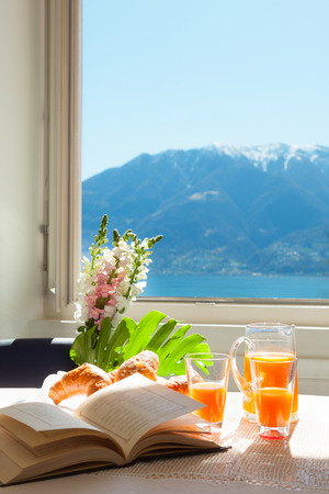 summer food: traditional breakfast on the table with lake view