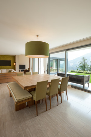 comfortable: Interior of a modern apartment furnished, comfortable dining room Stock Photo