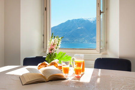 scenic view: Interior home, traditional breakfast on the table with lake view