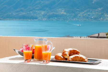 quiet: traditional breakfast on the balcony of a house, lake view