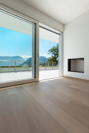living room wall: Interior, corner of a modern apartment, view fireplace and window Stock Photo