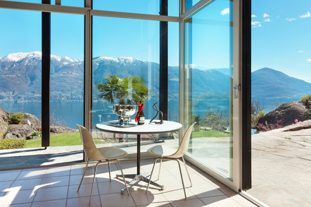veranda: aperitif on the veranda, interior of a mountain home, lake view