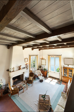 living style: interior of old house, classic furniture, living room with fireplace Stock Photo