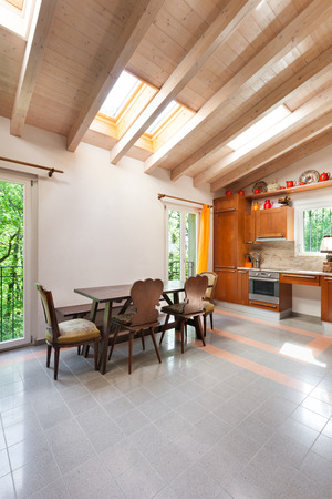 skylights: country house, lovely kitchen with wooden dining table