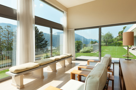 view window: Interior of a modern apartment furnished, wide living room