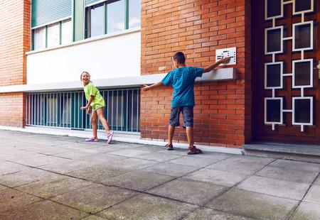run away: Children ring the bell and run away Stock Photo