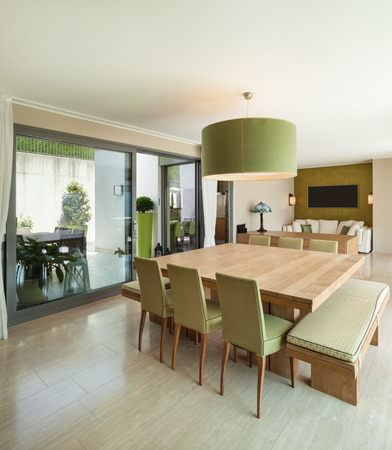 dining room interior: Interior of a modern apartment furnished, comfortable dining room Stock Photo