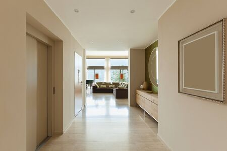 apartment building: Interior of modern apartment , living room view from corridor Stock Photo