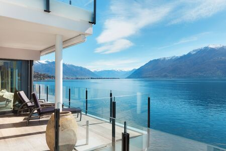 penthouse: beautiful terrace of a modern penthouse, lake view