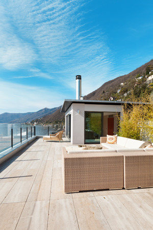 penthouse: modern architecture, beautiful lake view from the terrace of a penthouse Stock Photo